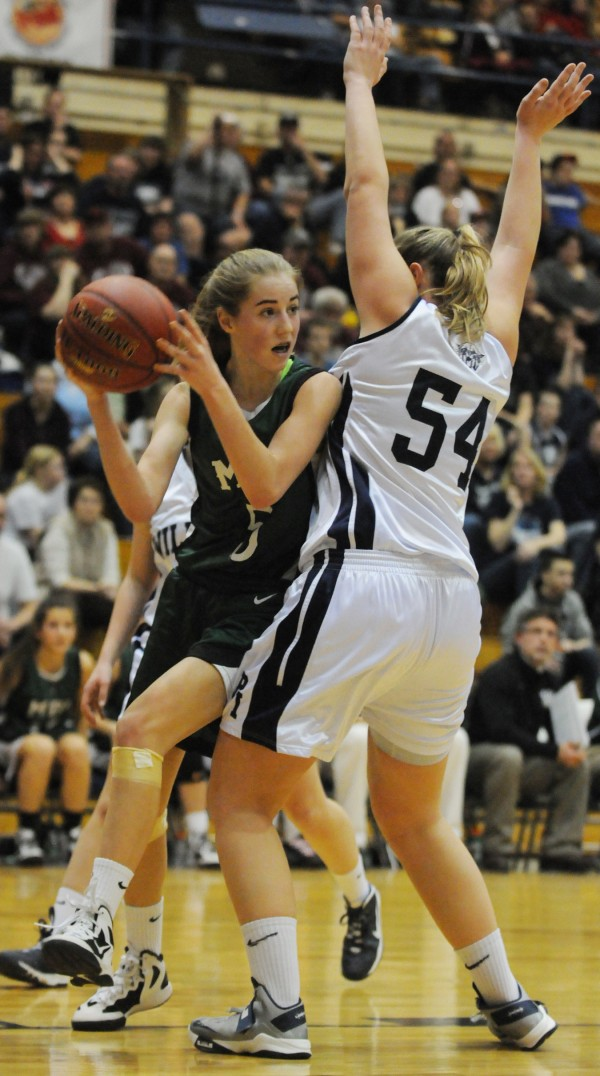 Mount Desert Island's Sarah Phelps looks to pass while being guarded by Presque Isle's Meredith Stewart during second half action on Wednesday at the Bangor Auditorium during Class B tourney action.