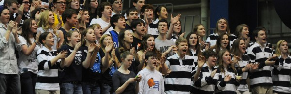 Presque Isle's student body and band cheer on their girls team as it defeats MDI on Wednesday at the Bangor Auditorium during Class B tourney action.