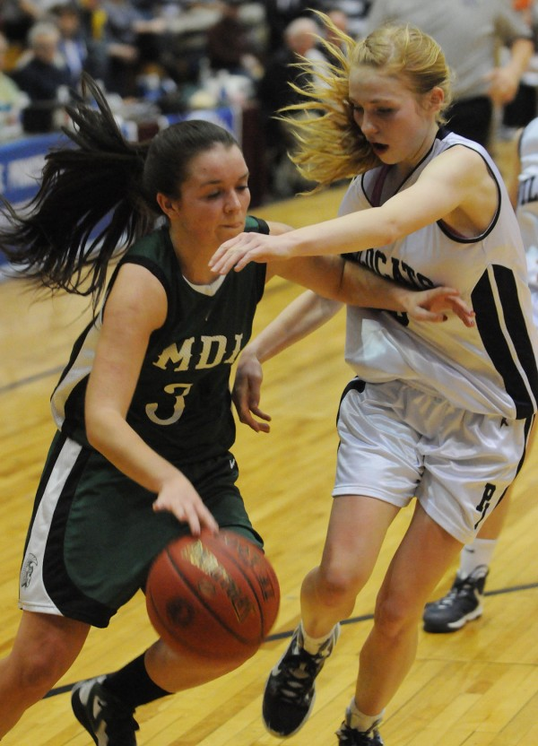Mount Desert Island's Sierra Myrick fends off Presque Isle's Karlee Bernier while making her way to the hoop during second half action on Wednesday at the Bangor Auditorium during Class B tourney action.