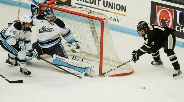Providence's Friar Ross Mauermann fails to complete the  wrap around on UMaine goalie Martin Ouellette and defenseman Conor Riley during third-period action at Orono on Friday, Feb. 1, 2013.