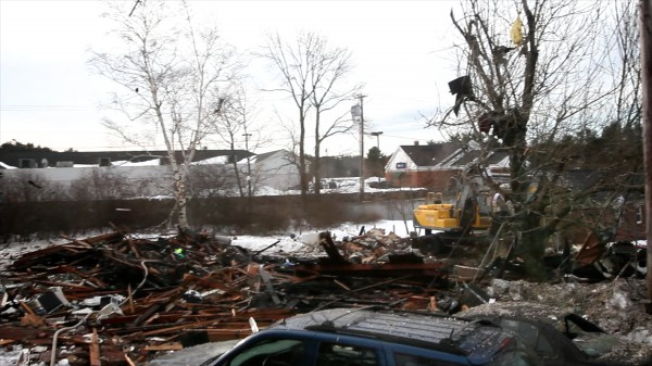The charred remains of a house on Bluff Road in Bath Tuesday, Feb. 12, 2013.