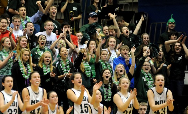 Mount Desert Island fans cheer for their girls team during the Trojans' quarterfinal win over Winslow on Saturday at the Bangor Auditorium. The MDI and Presque Isle girls and boys teams will play in Wednesday semifinals at Auditorium with the girls game at 3:35 p.m. and the boys game at 7:05 p.m.