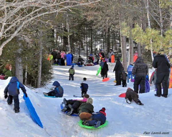 People of all ages have fun sledding at the 2012 Winter Family Fun Day at Aroostook State Park.