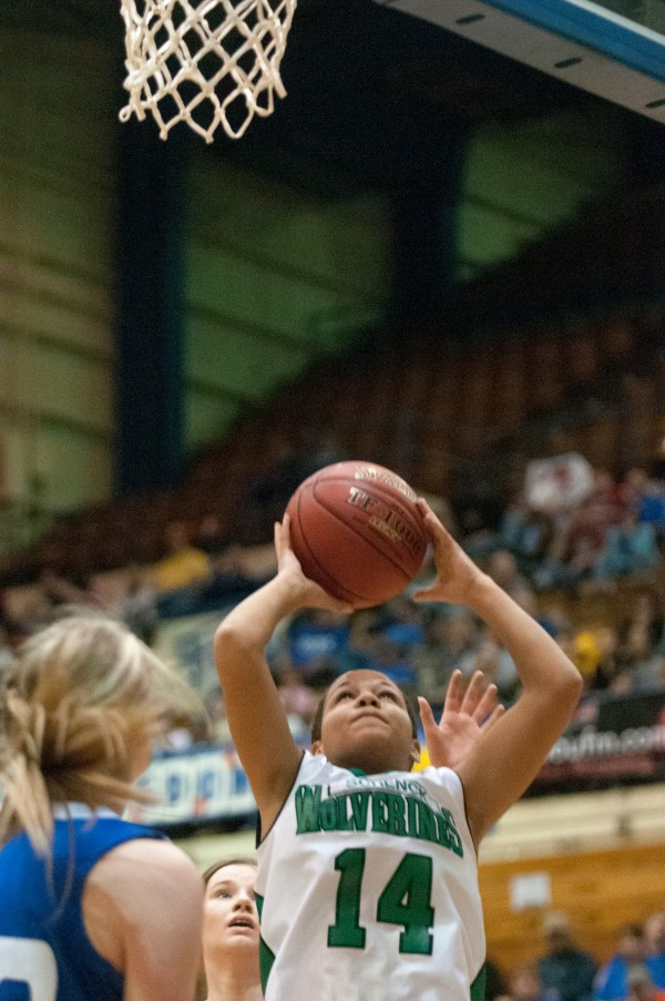 Schenck's Olivia Lewis (center) attempts a layup against Hodgdon at the Bangor Auditorium on Thursday, February 21, 2013.