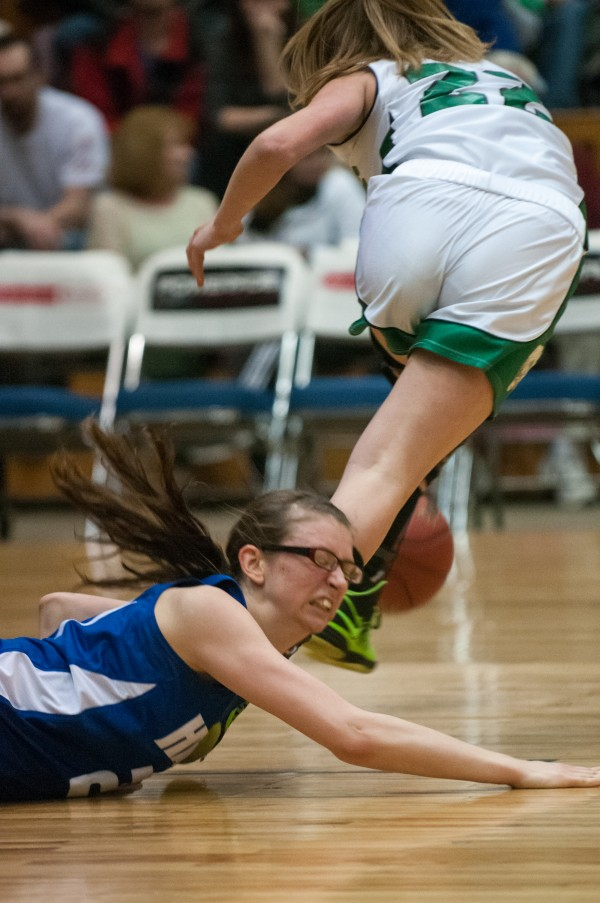 Hodgdon's Lauren Howell (left) hits the floor after wrestling for the ball against Schenck's Kristin Thompson (right) at the Bangor Auditorium on Thursday, February 21, 2013.