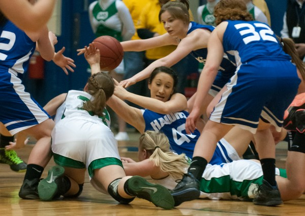 Hodgdon's Haley Gardiner (center) scrambles on the floor for the ball against Schenck's Taylor McLaughlin (left) and Katie Stanley (right) at the Bangor Auditorium on Thursday, Feb. 21, 2013.
