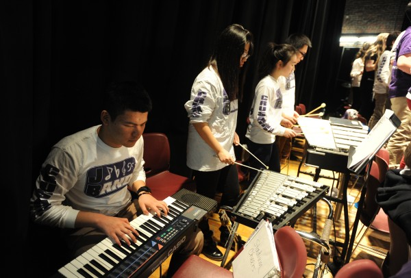Jim Yin (left), a first year international student from Hang Zhou, China, plays the keyboard in the John Bapst band on Thursday, Feb. 7, 2013. Yin, a sophomore, is one of 53 international students at John Bapst Memorial High School.  Abby Bi, Coco Yang and Jacob Ye (left to right) are also from China and enjoy playing in a school band, something their schools do not have in China.