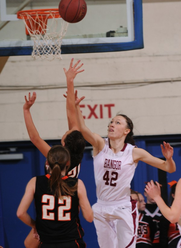 Brewer's Maddy Baily has her shot deflected  Bangor's Mary Butler during first period action on Thursday, Feb. 7, 2013, at the Bangor Auditorium.