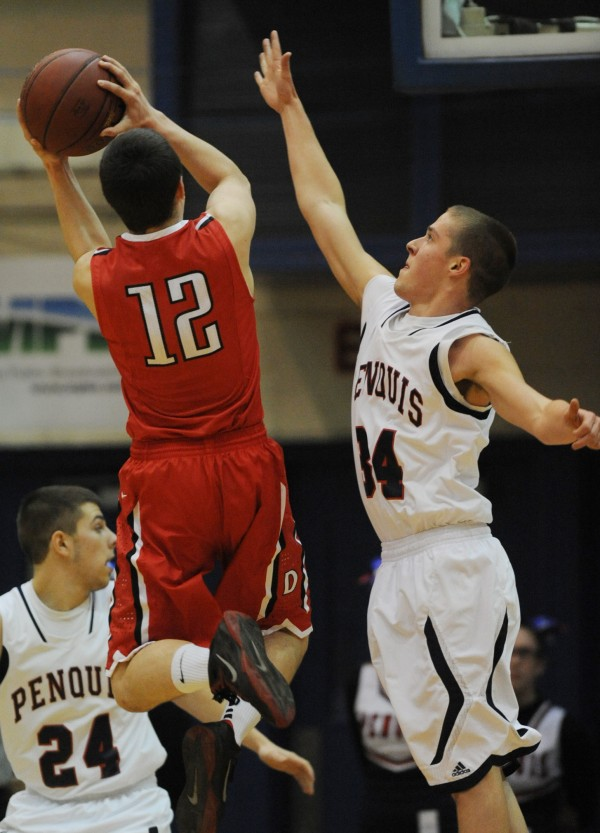 Dexter's Trevor Fogart shoots over Penquis' Tyler Pellitier during first-half action on Friday at the Bangor Auditorium.