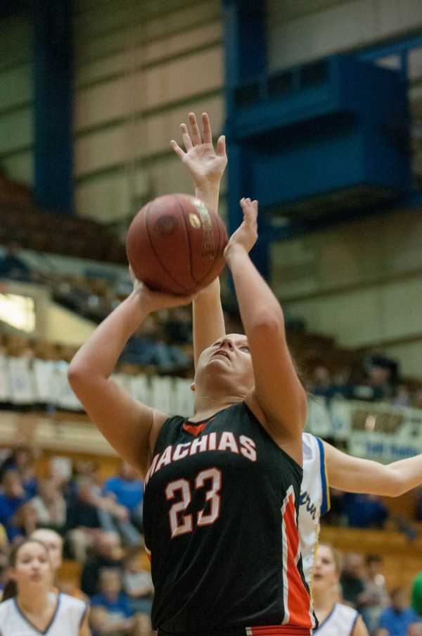 Machias' Caroline Proctor attempts a layup against Washburn at the Bangor Auditorium on Thursday, February 21, 2013.
