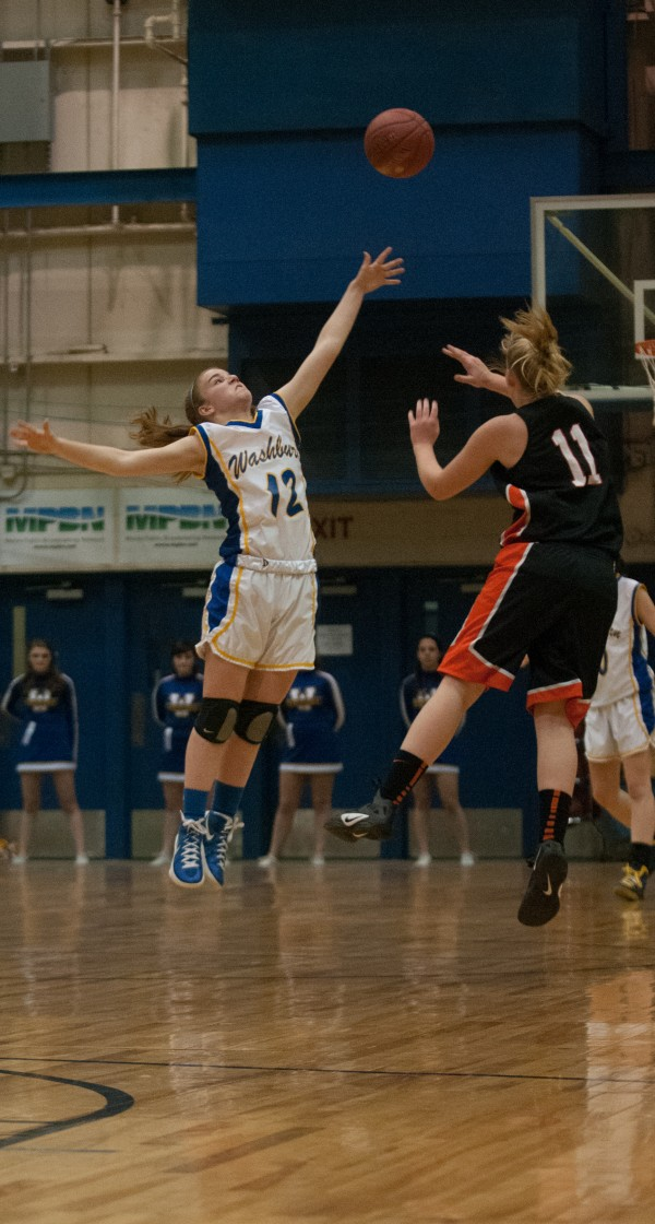 Washburn's Carmen Bragg (left) tries to intercept a pass sent from Machias' Rebecca Lee (right) at the Bangor Auditorium on Thursday, February 21, 2013.