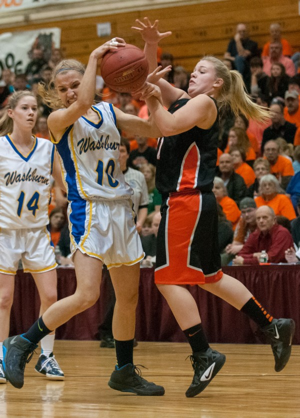 Washburn's Joan Overman (left) and Machias' Rebecca Lee (Right) battle for the basketball at the Bangor Auditorium on Thursday, February 21, 2013.