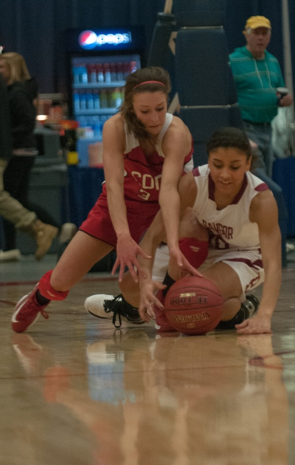 Cony's Josie Lee (left) and Bangor's Denae Johnson (right) fight for a loose ball at the Augusta Civic Center on Friday, Feb. 22, 2013.