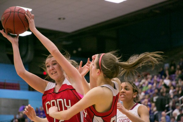 Cony's Logan Bayleigh (left) grabs a rebound at the Augusta Civic Center on Friday, Feb. 22, 2013.