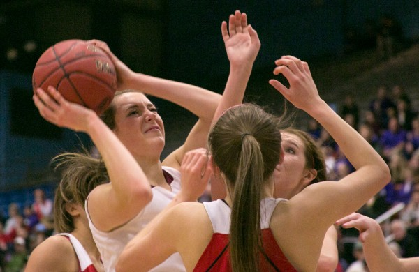Bangor's Cordelia Stewart (left) pushes up a shot over two Cony defenders at the Augusta Civic Center on Friday, Feb. 22, 2013.