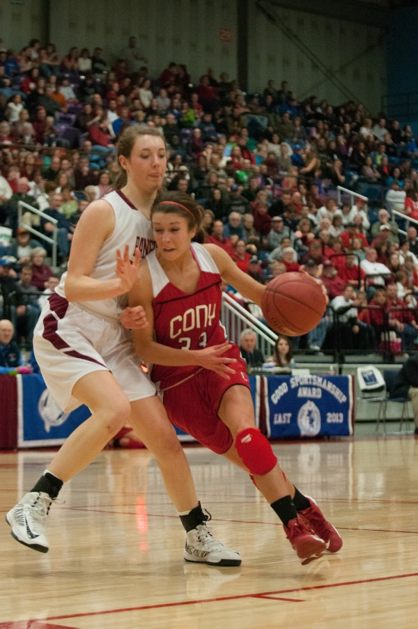 Bangor's Cordelia Stewart (left) defends Cony's Josie Lee (right)  at the Augusta Civic Center on Friday, Feb. 22, 2013.