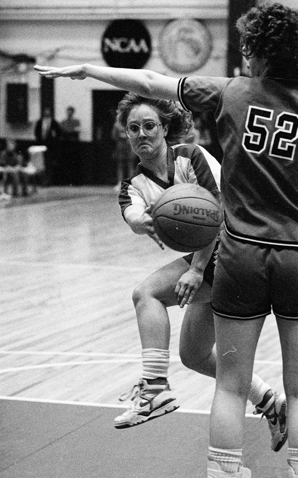 Cony's Marcie Lane passes off to a teammate past Presque Isle's Kerry Eaton in the Eastern Maine Class A final on March 11, 1989, at the Bangor Auditorium. Lane scored 31 points to lead Presque Isle to a 64-47 victory.