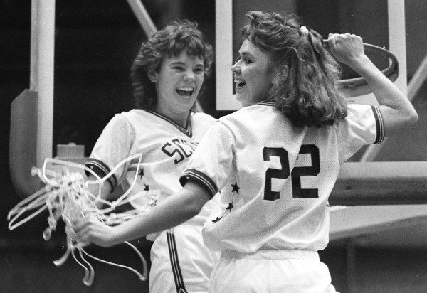 Schenck's Stephanie Carter (left) and Laurie Spearrin take down a net after their 70-64 victory over Central Aroostook in the Eastern Maine Class C final on Feb. 20, 1988 at the Bangor Auditorium. Carter scored what was then an EM tourney-record 46 points in the game.