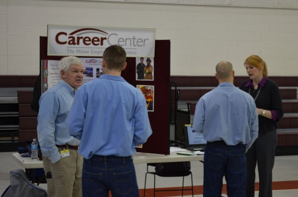 Mike Johnson (left) of Maine CareerCenter talks with an inmate of Charleston Correctional Facility at a career and college fair at the Mountain View Youth Development Center in Charleston on Tuesday, Feb. 12, 2013.