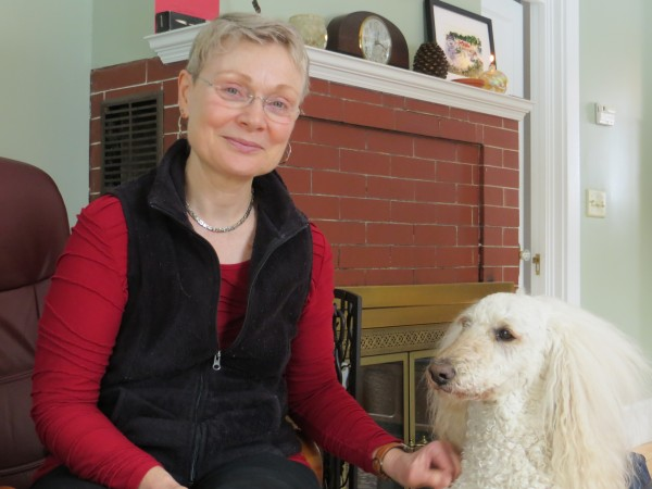 Molly Pitcher, certified prosthetist/orthotist and jazz singer, at home in Bangor with her dog, Dizzy.