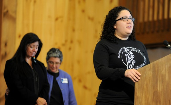 Lauren Stevens, 24, originally from Indian Township, sings Amazing Grace at the Maine Wabanaki-State Child Welfare Truth & Reconciliation Commissions day of reflection and seating of the TRC Commissioners. Lauren is a member of the Maine Youth United for Truth, Healing, Change. Denise Altvater (left) and Penthea Burns listen in the background.