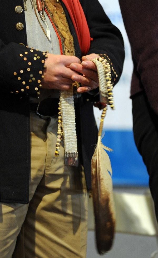 Commissioner gkisedtanamoogk holds a ceremonial wampum belt, which represents the basis of all things sacred, and an eagle feather, the symbol of the creator's presence, during the swearing in of the five commissioners of the Maine Wabanaki-State Child Welfare Truth and Reconciliation Commission.