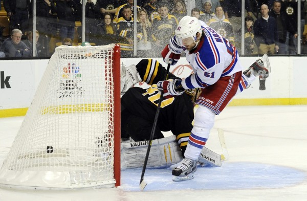 New York Rangers left wing Rick Nash (61) scores a goal during the shootout against  Boston Bruins goalie Tuukka Rask (40) at TD Garden.