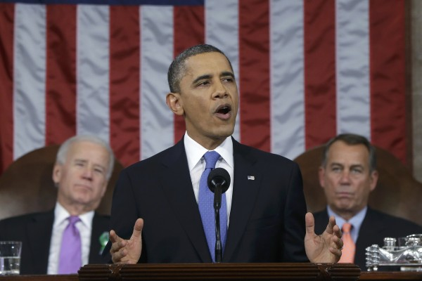 President Barack Obama, flanked by Vice President Joe Biden (L) and House Speaker John Boehner (R-Ohio), delivers his State of the Union speech on Capitol Hill in Washington, Feb. 12, 2013.