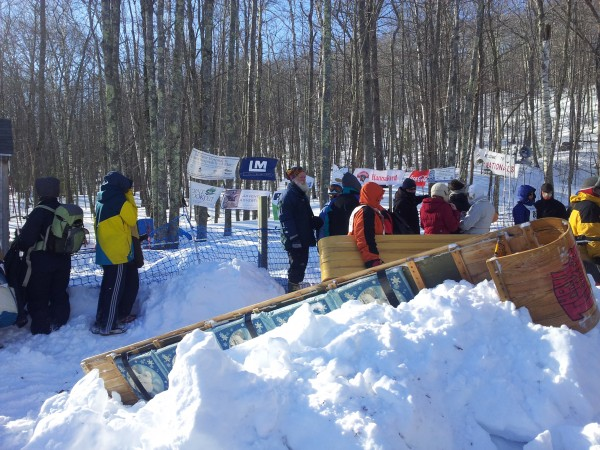 People gather beside the chute to watch the US National Toboggan Championship on Feb. 10, 2013 at Camden Snow Bowl. The competition and celebration attracted Maine residents from across the state, as well as competitors traveling from places such as Pennsylvania, Canada and New England, including a large group from Connecticut.