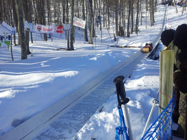 A two-person toboggan team races down the chute at  the US National Toboggan Championship on Feb. 10, 2013 at Camden Snow Bowl.