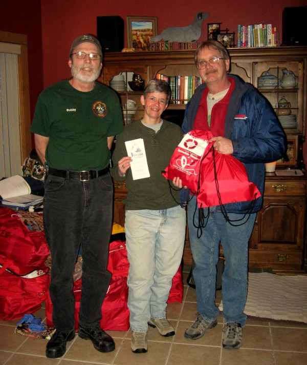Animal Control Officer from Western Maine, Bobby Silcott with Sebec resident and employee of Fresh Air Dogs in Guilford, Carol Morin and Sebec Fire Chief Ken Kelley