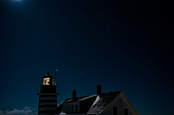 Brilliant starry sky and moonlight on West Quoddy Head Lighthouse in this unusual winter time composition.