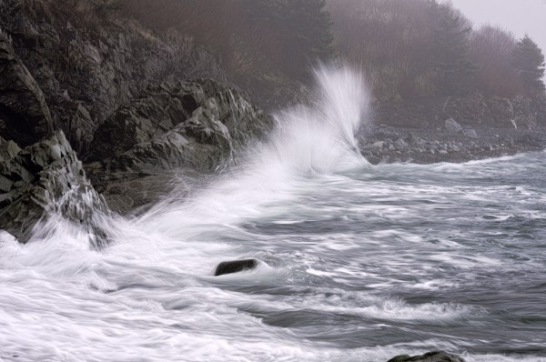 Ethereal waves crashing into shoreline rocks at Quoddy Head State Park