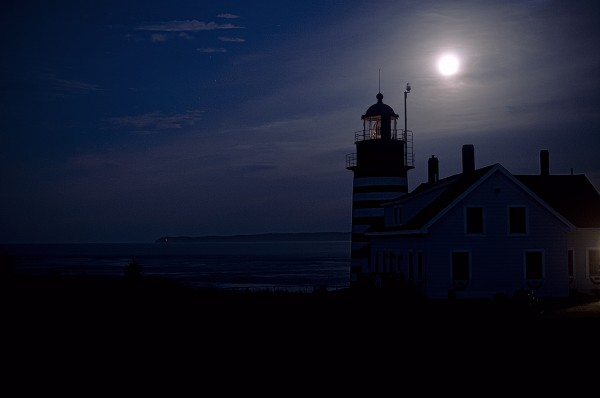 West Quoddy Head Lighthouse silhouetted in full moon