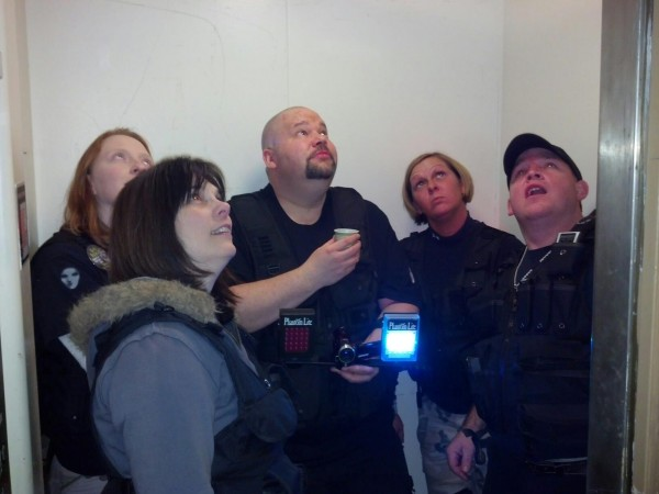 Members of East Ghost Ghost Trackers on paranormal investigation.