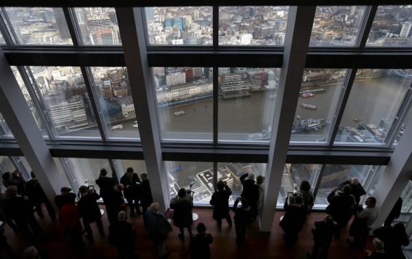 Visitors look out from windows in The View gallery at the Shard, western Europe's tallest building, in London on Feb. 1, 2013. The View, the public viewing deck accessible by high speed elevators on the 1,013-foot Shard building, opened to the public on Friday.