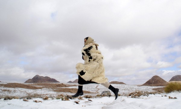 A man runs through snow after a snowstorm in the desert, near Tabuk, 932 miles from Riyadh on Feb. 1, 2013.