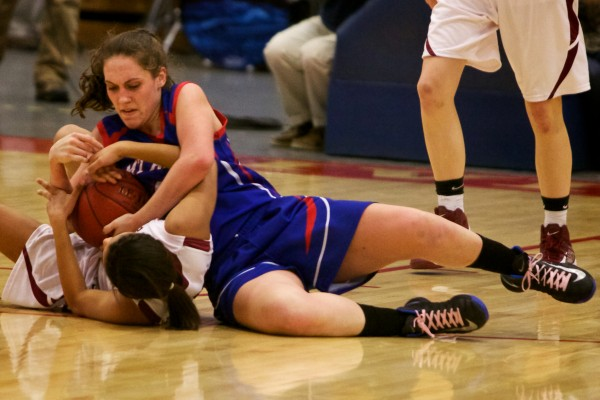 Mt. Ararat High School forward Mallory Nelson (top) and Bangor High School's Denae Johnson fight for the ball Wednesday at the Class A Eastern Semifinal basketball game in Augusta.