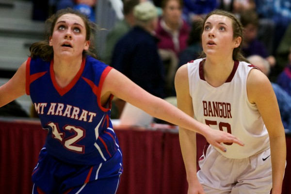 Mt. Ararat High School forward Mallory Nelson (left) and Bangor High School's Cordelia Stewart watch a free throw Wednesday at the Class A Eastern Semifinal basketball game in Augusta.