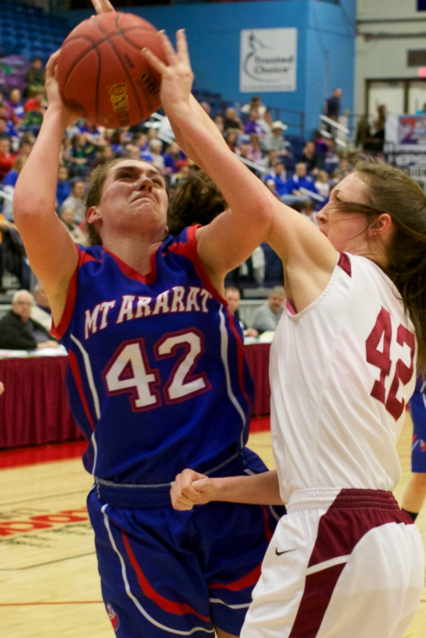 Mt. Ararat High School forward Mallory Nelson (left) tries to shoot around Bangor High School's Mary Butler Wednesday at the Class A Eastern Semifinal basketball game in Augusta.