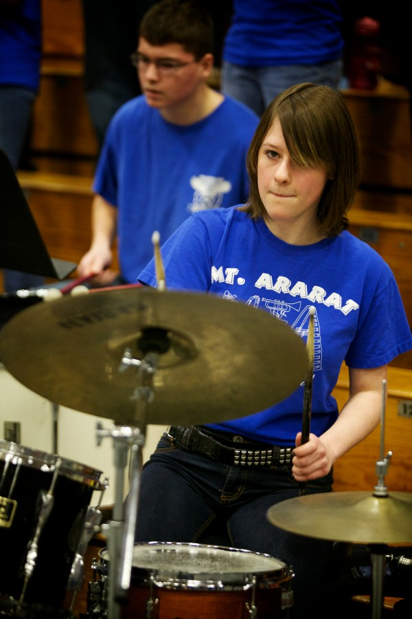 Mt. Ararat High School drummers Kristen Haines and Robbie Small keep the beat Wednesday at the Class A Eastern Semifinal basketball game in Augusta.