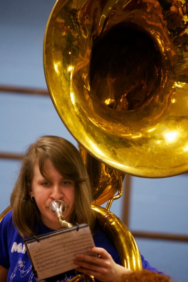 Mt. Ararat High School Sousaphone player Maggie Broughton plays Wednesday at the Class A Eastern Semifinal basketball game in Augusta.