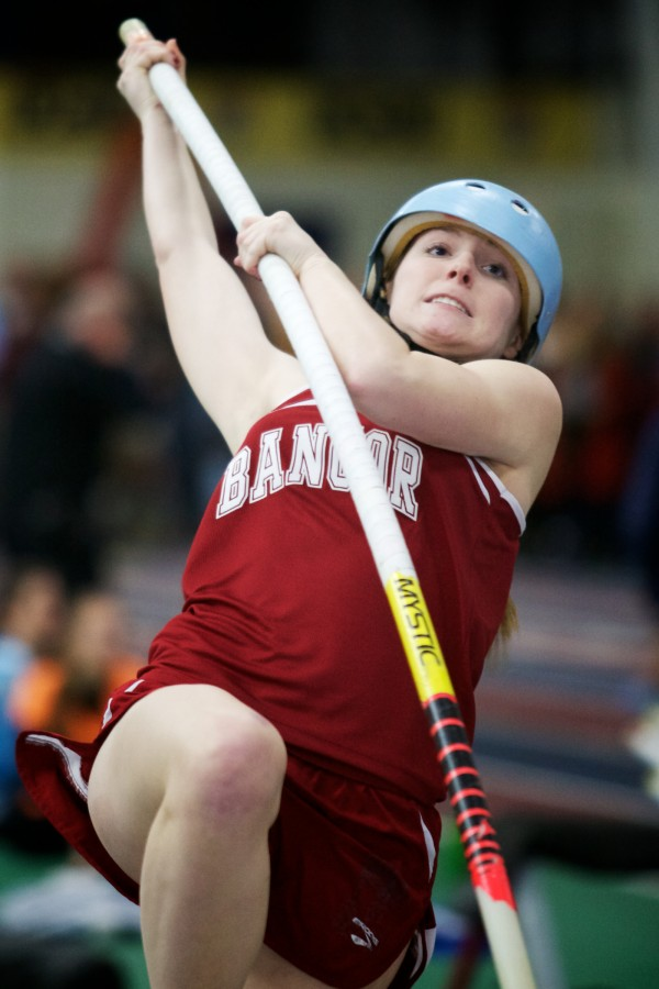 Bangor High School's Morgan Johnson starts a pole vault at the Class A State Indoor Track Championships in Gorham Monday. Johnson placed third overall.