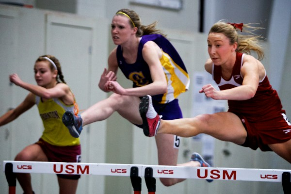 Grace MacClean (right) of Bangor High School competes in the 55 meter hurtles Monday at the Class A State Indoor Track Championships in Gorham.