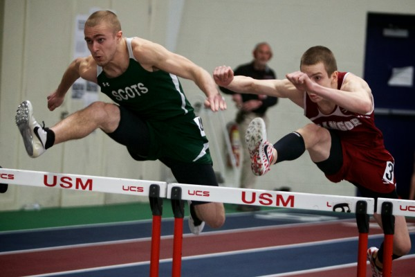 Andrew Fournier (right) of Bangor High School competes against Tyson Goodale of Bonny Eagle High Schoo in the 55 meter hurtles Monday at the Class A State Indoor Track Championships in Gorham.