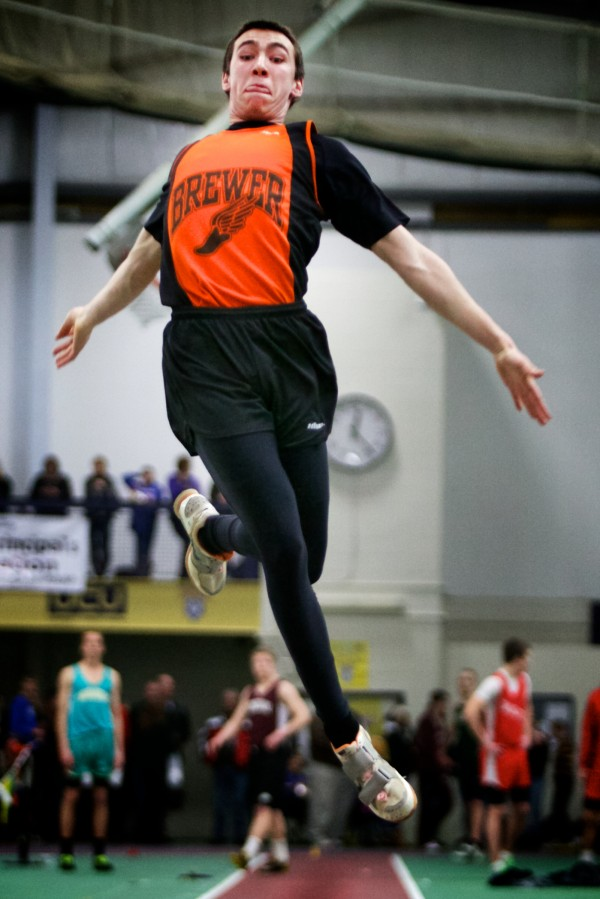 Jeremy Bissell of Brewer High School competes in the long jump Monday at the at the Class A State Indoor Track Championships in Gorham. Bissell finished first overall.
