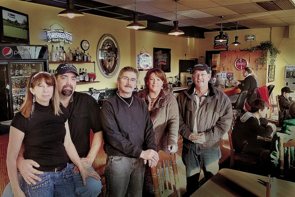 The Back Alley Pub has opened up the ownership of Tina Saccuto (left) and Dwayne Mcleod in the Family Fun Bowling Center, owned by Andy Meucci (center). Lori Levasseur (second from right) and John Johnson (right) are employees of the Back Alley Pub.