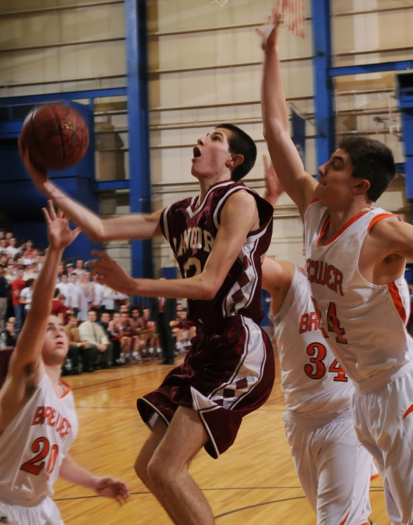 Bangor's Sean Tocci shoots in heavy traffic against Brewer on Thursday during 1st period action at the Bangor Auditorium.