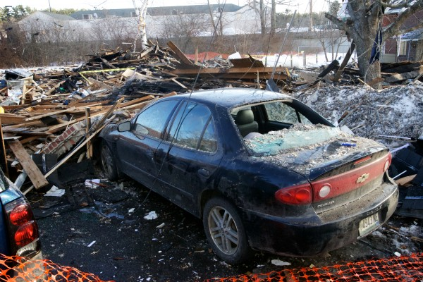 A car sits near the remains of a duplex on Bluff Road in Bath Wednesday, Feb. 13, 2013, where a propane leak and explosion killed Dale Ann Fussell, 64, Tuesday morning.