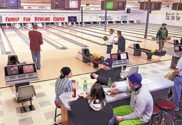 While the action continues in the lanes at the Family Fun Bowling Center in Bangor, some bowlers enjoy a lunch break (foreground).
